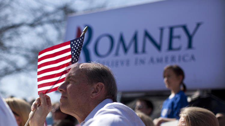 Supporters of Republican presidential candidate, former Massachusetts Gov. Mitt Romney watch as he speaks in St. Louis, Mo., Tuesday, March 13, 2012.  (AP Photo/Evan Vucci)