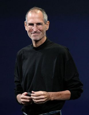 Steve Jobs wearing his signature St. Croix mock turtleneck. Photo by Getty Images