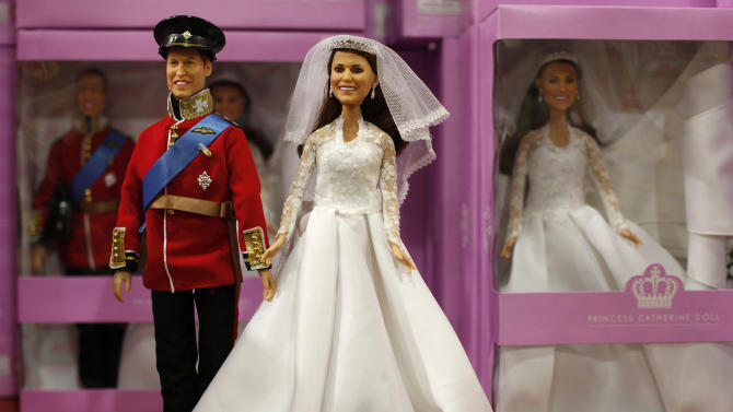 Britain's Prince William and Princess Catherine toy dolls are seen dressed as the royal couple were when they married as they go on sale in a toy department store in LondonThursday, Aug., 18, 2011. The two dolls together retail fro 100 pounds sterling, ( US $ 165 euro 115), though Catherine can be bought separately for half the price. (AP Photo/Alastair Grant)