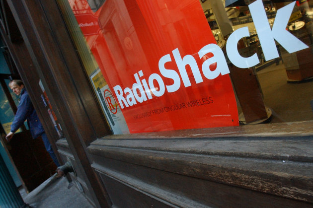 A customer leaves a RadioShack store in Boston.