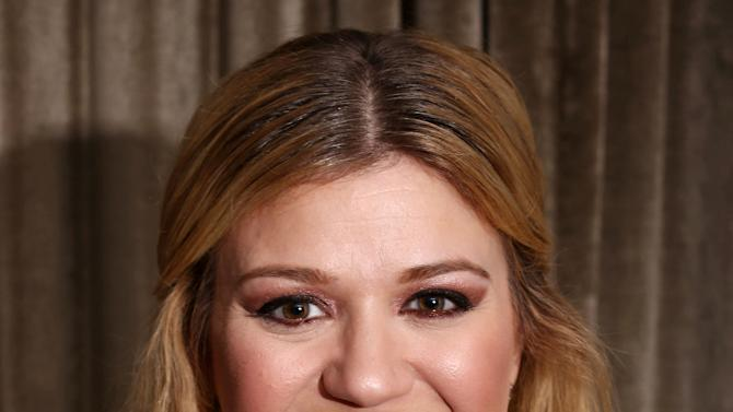 """In this Monday, Nov. 5, 2012 photo, musician Kelly Clarkson poses for a portrait in Los Angeles.  Clarkson's newest album, """"Greatest Hits: Chapter One,"""" is releasing on Monday, Nov. 19, 2012. (Photo by Matt Sayles/Invision/AP)"""