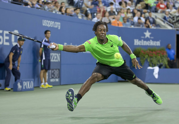 Gael Monfils reaches for a shot during his match against Roger Federer. (USA TODAY Sports)