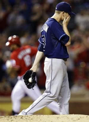 Ump admits ending mistake, Rangers beat Rays 5-4