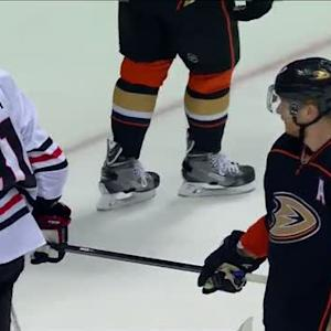 Perry tries to steal Hossa's stick