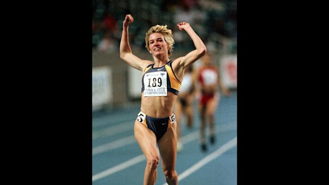 FILE - In this Feb. 27, 1999, file photo, Suzy Hamilton reacts after winning the women's 1,500 meter run with a time of 4:13.96 at the USA Championships athletics meet in Atlanta. he three-time Olympian has admitted leading a double life as an escort. She apologized Thursday, Dec. 20, 2012, after a report by The Smoking Gun website said she had been working as a prostitute in Las Vegas.  (AP Photo/John Bazemore, File)