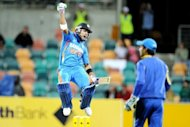 Indian batsman Virat Kohli leaps in the air after scoring his century against Sri Lanka in their ODI in Hobart on Tuesday. India stormed to a seven-wicket victory over Sri Lanka, earning the bonus point they needed to stay in the hunt for a place in the tri one-day series finals