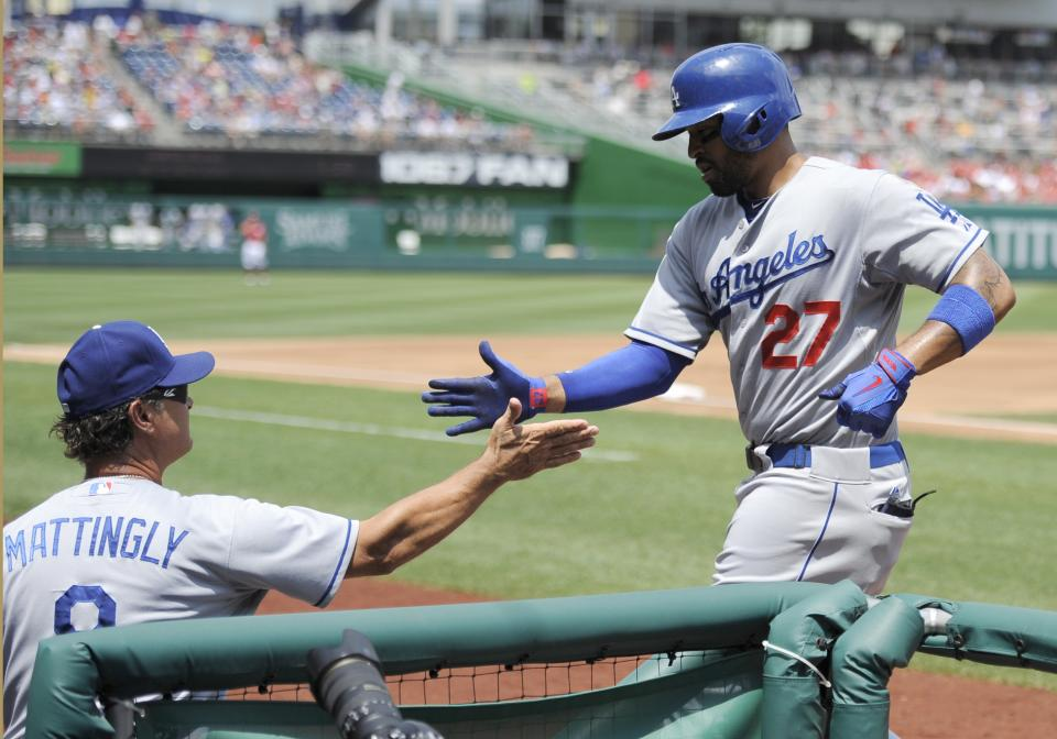 Los Angeles Dodgers' Matt Kemp (27) celebrates his home run with manager Don Mattingly during the second inning of a baseball game against the Washington Nationals, Sunday, July 21, 2013, in Washington. (AP Photo/Nick Wass)