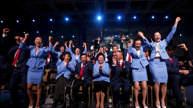 Members of the Beijing delegation celebrate after Beijing was awarded the 2022 Winter Olympic Games, defeating Almaty in the final round of voting, during the 128th IOC session in Kuala Lumpur