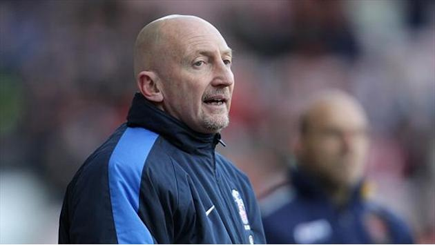 Football - Holloway happy with point