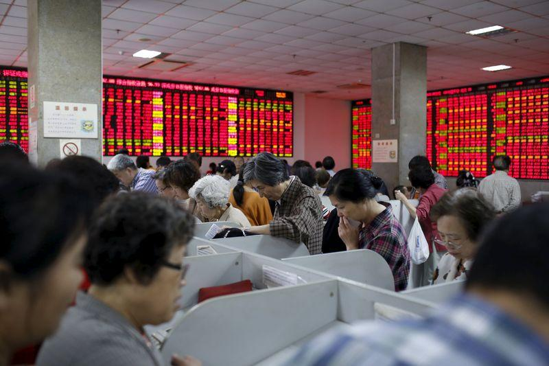 Corrected - China markets plunge in record turnover as margin traders take fright