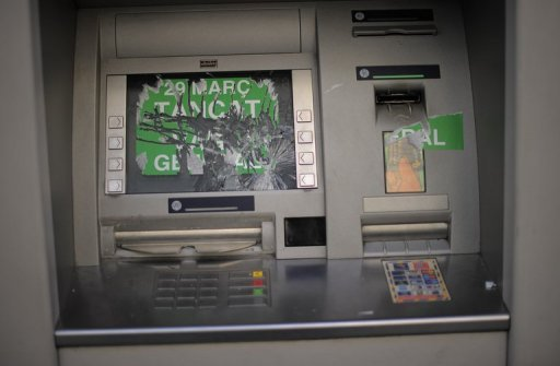 <p>A damaged ATM in Barcelona. Bad loans held by Spain's crisis-torn lenders soared to its highest level in 50 years in July with nearly one in ten loans deemed at risk.</p>