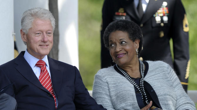 Former President Bill Clinton sits next to Myrlie Evers-Williams, the widow of slain civil rights activist Medgar Evers, during the 50th anniversary remembrance ceremony of his death, Wednesday, June 5, 2013,  at Arlington National Cemetery in Arlington, Va. (AP Photo/Susan Walsh)