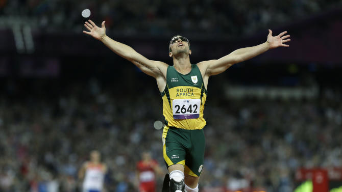FILE - In this Sept. 8, 2012 file photo, South Africa's Oscar Pistorius wins gold in the men's 400-meter T44 final at the 2012 Paralympics in London. A judge in South Africa says Pistorius, who is charged with murdering his girlfriend, can leave South Africa to compete in international competition, with conditions. (AP Photo/Kirsty Wigglesworth, File)