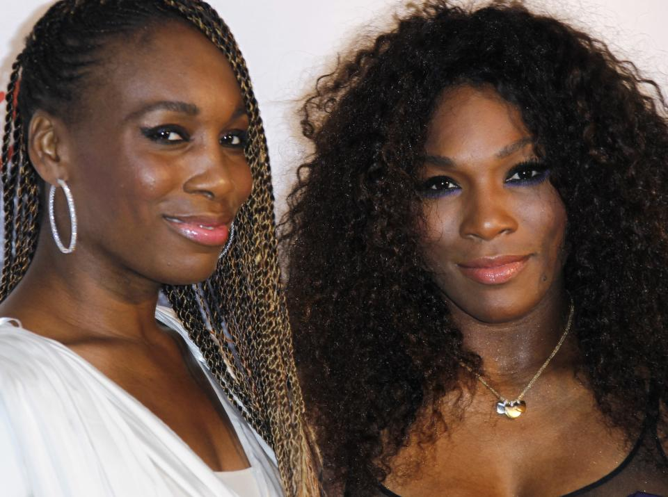U.S tennis players and sister's Venus, and Serena Williams, right, arrive for the Pre-Wimbledon Party, at Kensington Roof Gardens in west London, Thursday June 21, 2012. (AP Photo/Joel Ryan)