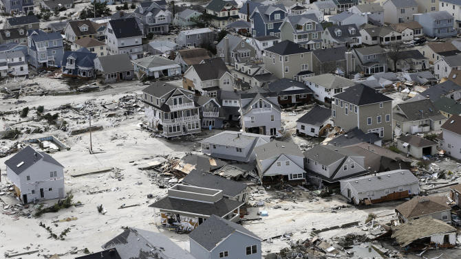 FILE - This Oct. 31, 2012 file photo shows the destroyed homes left in the wake of superstorm Sandy in Seaside Heights, N.J. Superstorm Sandy may have one more nasty surprise still to come: higher taxes. Unless shore towns from Rhode Island to New Jersey get a big influx of aid from the state and federal governments, which are themselves strapped for cash, they will have no choice but to raise taxes on homes and businesses that survived to make up for the loss.(AP Photo/Mike Groll, file)