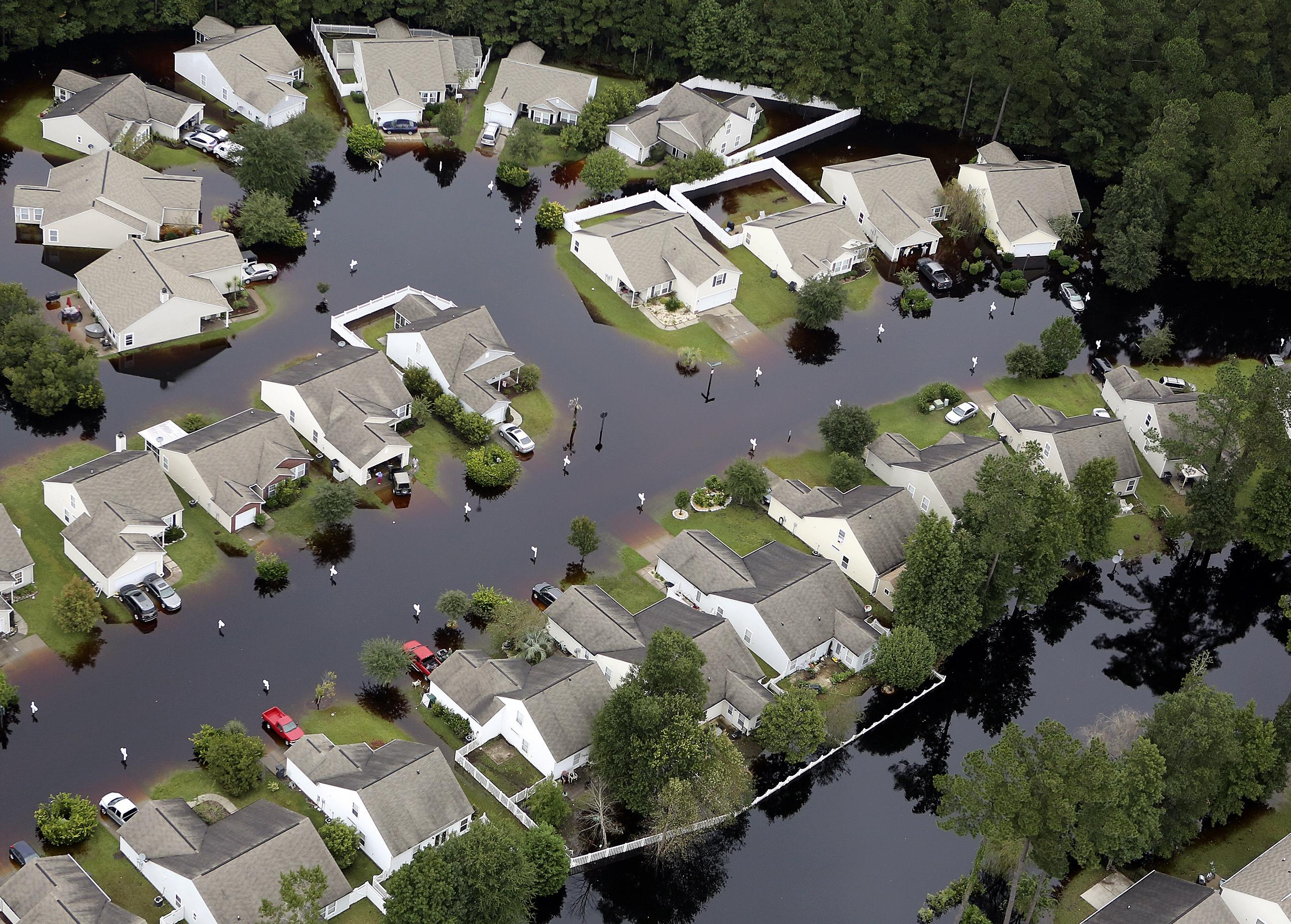South Carolina cleans up, but worries remain amid floods