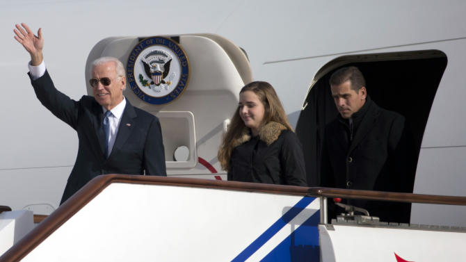 FILE - This Dec. 4, 2013, file photo shows U.S. Vice President Joe Biden, left, arriving on Air Force Two in Beijing, China, with his son Hunter Biden, right, and his granddaughter Finnegan Biden. As the Vice President travels to Ukraine Saturday, June 7, 2014, his youngest son, Hunter, 44, has been hired by a private Ukrainian company that promotes energy independence from Russia, but is commercially active in the breakaway Russian-backed state of Crimea and owned by a former government minister with ties to Ukraine's ousted pro-Russian president. (AP Photo/Ng Han Guan, Pool)