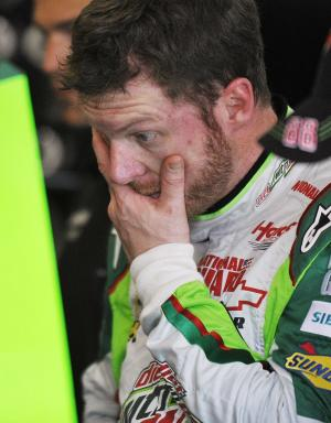 NASCAR driver Dale Earnhardt Jr., watches as crew members work on his car in the garage at Talladega Superspeedway in Talladega, Ala., Friday, Oct. 5, 2012. The drivers are preparing for Sunday's running of the NASCAR Sprint Cup Series auto race. (AP Photo/Rainier Ehrhardt)