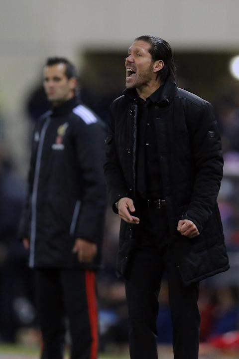 Atletico's coach Diego Simeone gestures during a Spanish La Liga soccer match between Atletico de Madrid and Levante at the Vicente Calderon stadium in Madrid, Spain, Saturday, Dec. 21, 2013
