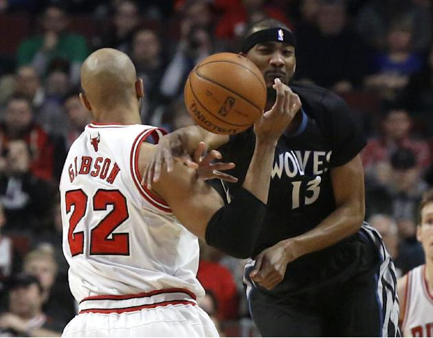 Minnesota Timberwolves forward Corey Brewer (13) knocks the ball from the hands of Chicago Bulls forward Taj Gibson (22) during the first half of an NBA basketball game, Monday, Jan. 27, 2014, in Chic