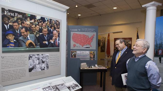 "In this Tuesday, Feb. 12, 2013 photo, curator Bob Bostock, a former Nixon aide who designed the original Watergate exhibit, left, and co-curator Frank Gannon,  tour the new exhibit: ""Patriot. President. Peacemaker,"" a new special exhibit opening Feb. 15 at the Richard Nixon Presidential Library and Museum in Yorba Linda, Calif. (AP Photo/Damian Dovarganes)"