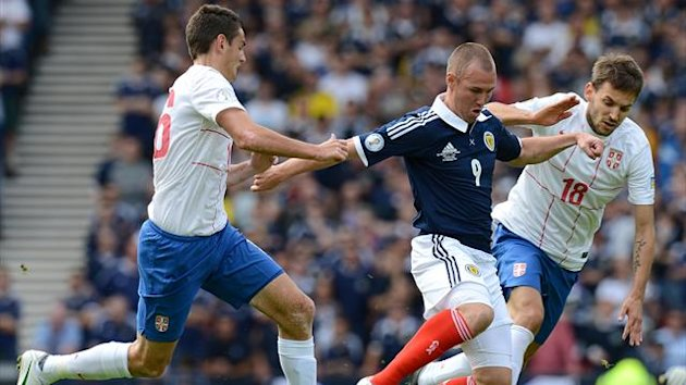 Kenny Miller, centre, in action against Serbia
