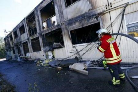 File picture shows a German firefighter examining a building used as an asylum shelter after a fire broke-out in Rottenburg
