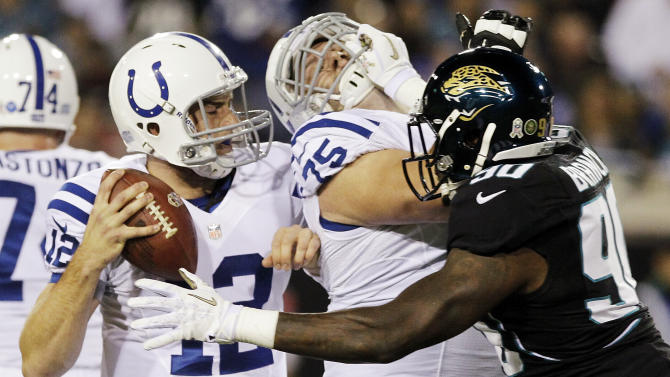 Jacksonville Jaguars defensive end Andre Branch (90) pressures Indianapolis Colts quarterback Andrew Luck, left, as guard Mike McGlynn (75) blocks during the first half of an NFL football game, Thursday, Nov. 8, 2012, in Jacksonville, Fla. (AP Photo/John Raoux)