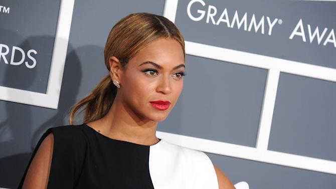 """FILE - This Feb. 10, 2013 file photo shows Beyonce at the 55th annual Grammy Awards in Los Angeles. Festival organizers announced Wednesday, April 10, on Spotify that Beyonce will perform at the """"Budweiser Made in America"""" music festival on Labor Day weekend. The festival was curated by her husband Jay-Z. (Photo by Jordan Strauss/Invision/AP, file)"""