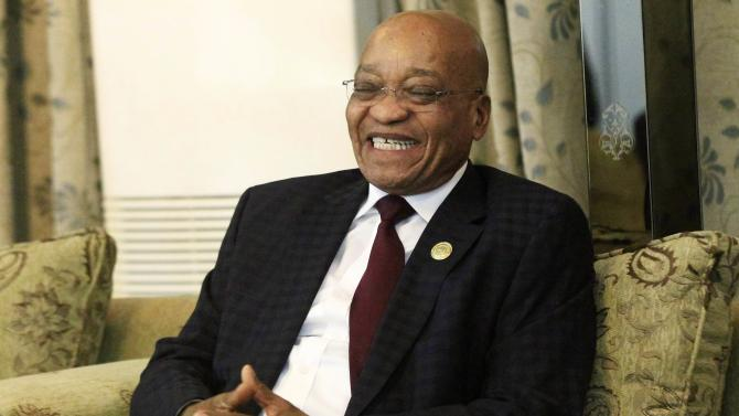 South Africa's President Jacob Zuma smiles during his official visit in Khartoum