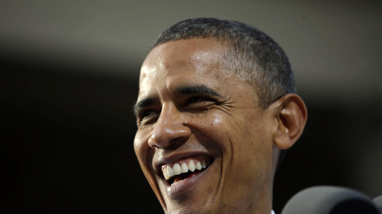 Obama hits Romney on taxes, Massachusetts record