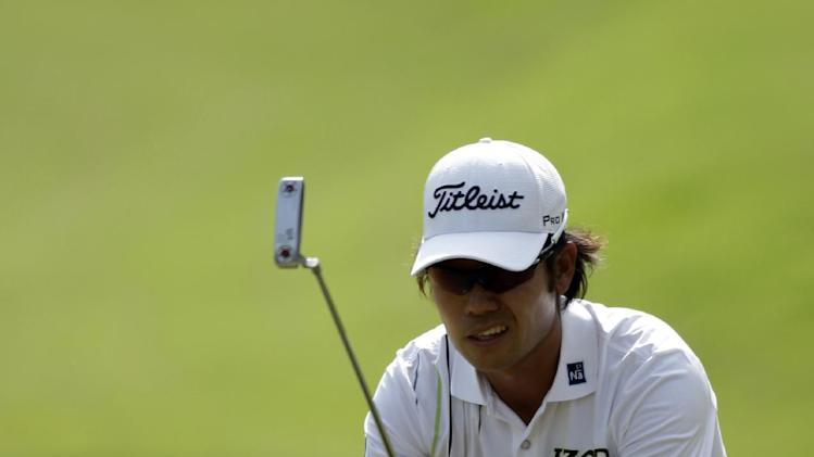Kevin Na looks at his shot on the eighth green during the third round of the Players Championship golf tournament at TPC Sawgrass, Saturday, May 12, 2012, in Ponte Vedra Beach, Fla. (AP Photo/Chris O'Meara)