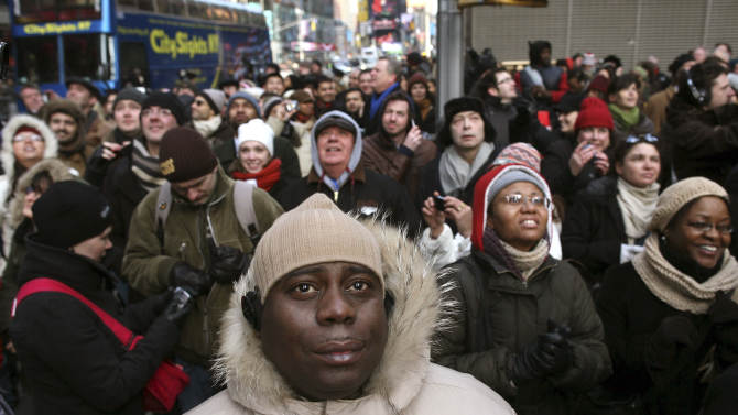 Spectators watch the inauguration of Barack Obama as the 44th President of the United States of America in New York's Times Square