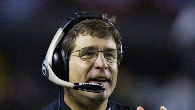"FILE - Oakland Raiders head coach Bill Callahan cheers as his team scores against the Pittsburgh Steelers in the Raiders' 30-17 win in Pittsburgh in this Sunday, Sept. 15, 2002 file photo. Former Oakland coach Bill Callahan denied allegations made by two of his former players that he ""sabotaged"" the Raiders in their Super Bowl loss to Tampa Bay 10 years ago Tuesday Jan. 22, 2013.  (AP Photo/ Gary Tramontina, File)"