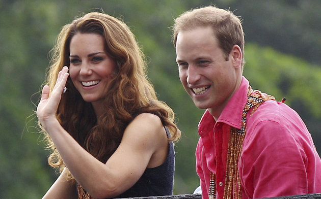 Britain&#39;s Prince William and his wife Kate, the Duke and Duchess of Cambridge, smile as they watch a shark ceremony as they arrive at Marapa Island, Solomon Islands, Monday, Sept. 17, 2012. (AP Photo/Rick Rycroft, Pool)