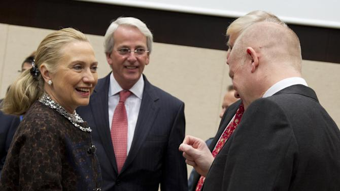 U.S. Secretary of State Hillary Clinton, left, speaks with British Foreign Minister William Hague, right, during a meeting of NATO foreign ministers at NATO headquarters in Brussels on Wednesday, Dec. 5, 2012. NATO foreign ministers were set Wednesday to shift their focus to the way forward in Afghanistan during a second day of talks in Brussels, as the military alliance prepares to withdraw its combat troops in 2014. (AP Photo/Virginia Mayo)