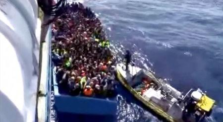 Boat packed with migrants sinks off Libya; up to 200 feared dead