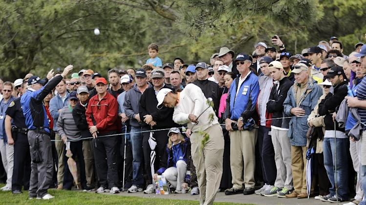 Tiger Woods hits his second shot from the left rough on the second hole of the South Course at Torrey Pines during the first round of the Farmers Insurance Open golf tournament, Thursday, Jan. 24, 2013, in San Diego. (AP Photo/Lenny Ignelzi)
