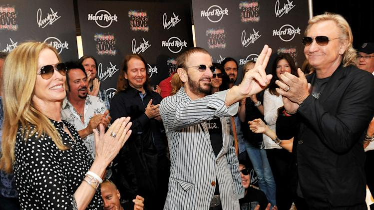In this photo provided by Rob Shanahan, musician Ringo Starr, center, celebrates his 72nd birthday with his wife Barbara Bach, left, and musician Joe Walsh, right, at The Hard Rock Cafe, Saturday, July 7, 2012, in Nashville, Tenn. (AP Photo/Rob Shanahan)