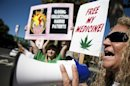 Kevai Floyd protests law enforcement actions against medical marijuana outside the federal courthouse in Sacramento.
