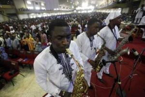 Choir members play saxophones during a church service …