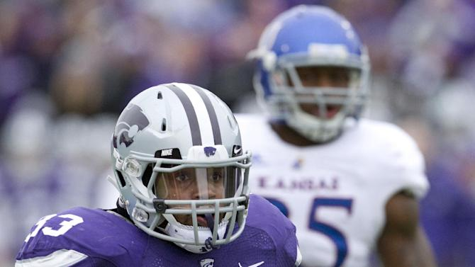 Kansas State running back John Hubert (33) runs for a touchdown past Kansas defensive end Toben Opurum (35) during the first half of an NCAA college football game in Manhattan, Kan., Saturday, Oct. 6, 2012. (AP Photo/Orlin Wagner)