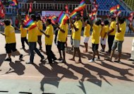 Participants hold Nepalese and rainbow flags during the opening ceremony of the first South Asia Lesbian, Gay, Bisexual and Transgender Sports Festival in Kathmandu on Friday
