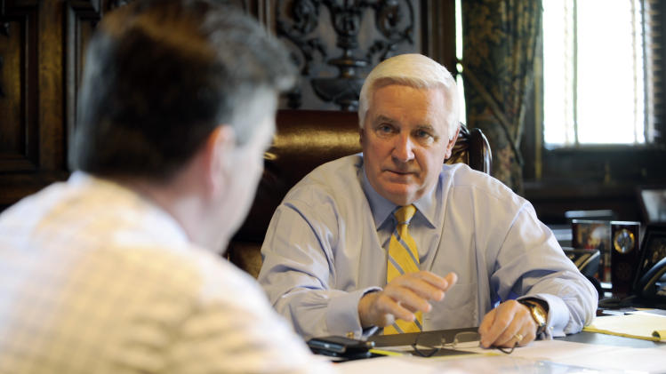 Pennsylvania Gov. Tom Corbett, right, confers with Lt. Gov. Jim Cawley, left, in his capitol office  prior to the final vote to approve the 2011-12 state budget Wednesday, June 29, 2011 in Harrisburg, Pa. The budget bill passed the Republican-controlled state Senate late Tuesday on a party-line vote. It is expected to win approval in the House and sent to Gov. Tom Corbett before the June 30 midnight deadline. (AP Photo/Bradley C. Bower)