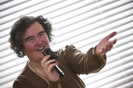 FILE - In this April 16, 2009 file photo, Susan Boyle, whose performance on the television show &quot;Britain&#39;s Got Talent&quot; wowed the judges, poses singing with a hairbrush at her home in Blackburn, Scotland. But what happened next for Susan Boyle? The middle-aged church volunteer from a small town in Scotland became an instant global celebrity in 2009 with her heart-stopping rendition of the &quot;Les Miserables&quot; number &quot;I Dreamed a Dream&quot; on a TV talent show. A week is a long time in showbiz _ and in our hyper-speed online age three and a half years is an eternity _ but Boyle is still going strong. She has sold millions of records, received an honorary doctorate, sung for Pope Benedict XVI and performed in Las Vegas. A stage musical about her life has played to enthusiastic crowds across Britain and is headed for Australia, and next month she releases her fourth album, &quot;Standing Ovation.&quot; (AP Photo, File)