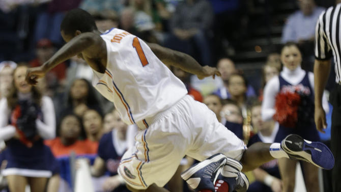 Mississippi forward Murphy Holloway (31) passes the ball as Florida guard Kenny Boynton (1) jumps over during the first half of an NCAA college basketball game in the final round of the Southeastern Conference tournament, Sunday, March 17, 2013, in Nashville, Tenn. (AP Photo/John Bazemore)