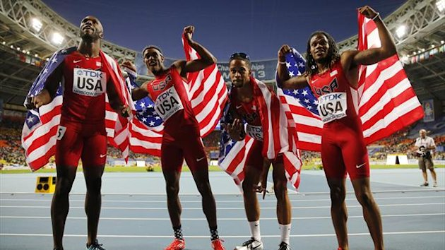 Members of the U.S. relay team hold their national flags after winning the men's 4x400 metres relay final during the IAAF World Athletics Championships at the Luzhniki stadium in Moscow (Reuters)