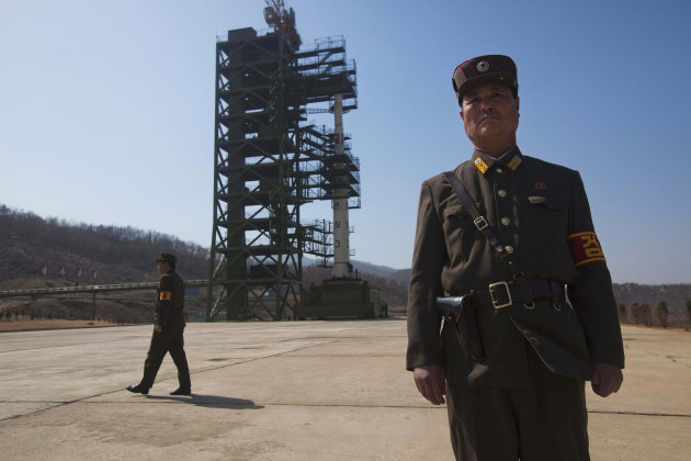 North Korean soldiers stands in front of the country's Unha-3 rocket, slated for liftoff between April 12-16, at Sohae Satellite Station in Tongchang-ri, North Korea on Sunday April 8, 2012. North Kor