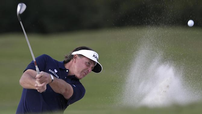 Phil Mickelson hits out of a sand trap on the 16th hole during the third round of the Cadillac Championship golf tournament, Saturday, March 9, 2013 in Doral, Fla. (AP Photo/Wilfredo Lee)