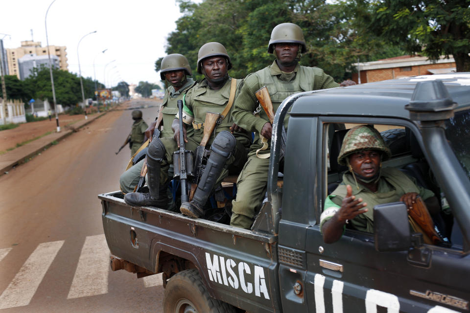 FILE-In this file photo taken on Thursday, May 29, 2014, African Union MISCA troops from Cameroon patrol in Bangui, Central African Republic. The...